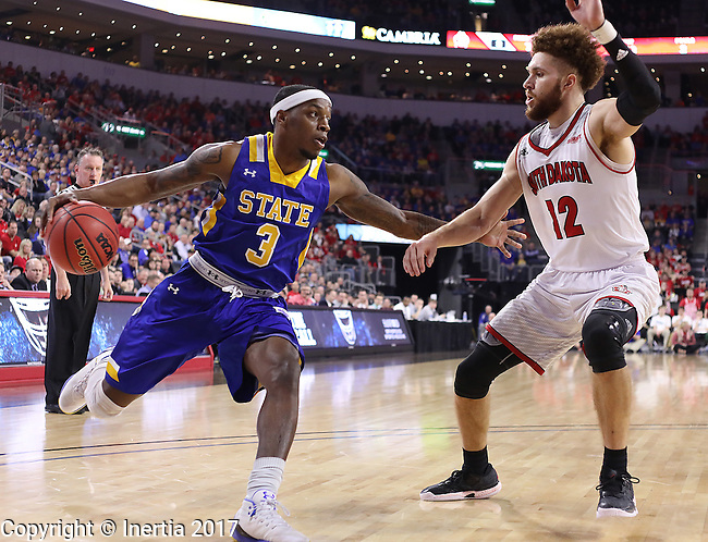 SIOUX FALLS, SD: MARCH 6: Tevin King #3 of South Dakota State drives toward Trey Burch-Manning #12 of South Dakota during the Summit League Basketball Championship on March 6, 2017 at the Denny Sanford Premier Center in Sioux Falls, SD. (Photo by Dick Carlson/Inertia)