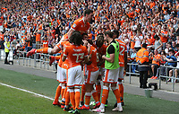 Blackpool's Jay Spearing is swamped by team-mates as he celebrates scoring the opening goal<br /> <br /> Photographer Stephen White/CameraSport<br /> <br /> The EFL Sky Bet League One - Blackpool v Fleetwood Town - Monday 22nd April 2019 - Bloomfield Road - Blackpool<br /> <br /> World Copyright © 2019 CameraSport. All rights reserved. 43 Linden Ave. Countesthorpe. Leicester. England. LE8 5PG - Tel: +44 (0) 116 277 4147 - admin@camerasport.com - www.camerasport.com