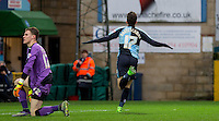 Max Kretzschmar of Wycombe Wanderers goal celebrations as Callum Preston of Crawley Town is left in disappointment during the Sky Bet League 2 match between Wycombe Wanderers and Crawley Town at Adams Park, High Wycombe, England on 28 December 2015. Photo by Andy Rowland / PRiME Media Images