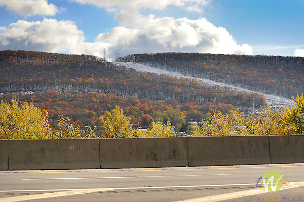 Mountainside with utility power corridor. Late autumn with snowfall. South Williamsport, PA.