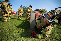 NWA Democrat-Gazette/JASON IVESTER <br /> Probationary Fire Fighter Allen Whitlow pulls himself through a confined space on Wednesday, Aug. 26, 2015, at the Rogers Fire Department's training center. Firefighters with Ladder 1, Engine 2, Engine 6 and Medic 1 were at the center going through quarterly training.