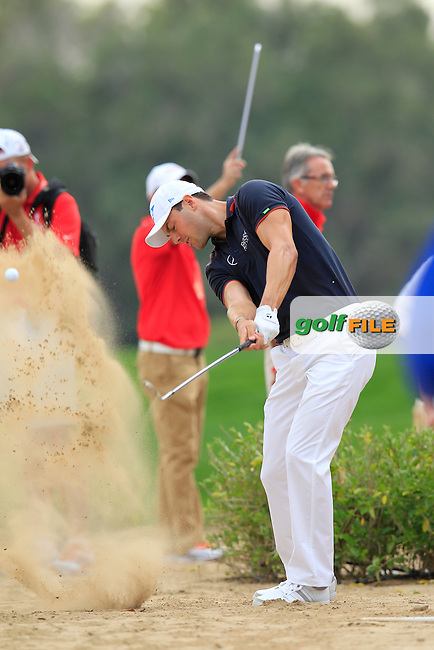 Martin Kaymer (GER) plays his drop shot on the 13th hole during Sunday's Final Round of the Abu Dhabi HSBC Golf Championship 2015 held at the Abu Dhabi Golf Course, United Arab Emirates. 18th January 2015.<br /> Picture: Eoin Clarke www.golffile.ie