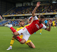 Fleetwood Town's Ched Evans is brought down by Oxford United's Luke Garbutt<br /> <br /> Photographer David Shipman/CameraSport<br /> <br /> The EFL Sky Bet League One - Oxford United v Fleetwood Town - Saturday August 11th 2018 - Kassam Stadium - Oxford<br /> <br /> World Copyright &copy; 2018 CameraSport. All rights reserved. 43 Linden Ave. Countesthorpe. Leicester. England. LE8 5PG - Tel: +44 (0) 116 277 4147 - admin@camerasport.com - www.camerasport.com