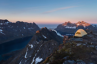 Summit camp on Helvetestind mountain peak, Moskenesøy, Lofoten Islands, Norway