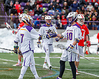 University at Albany Men's Lacrosse defeats Cornell 11-9 on Mar 4 at Casey Stadium.Kyle McClancy (#40) congratulates Mitch Laffin (#7).