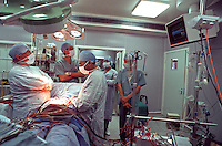 Surgeons performing heart transplant surgery in a hospital operating theatre..This image may only be used to portray the subject in a positive manner..©shoutpictures.com..john@shoutpictures.com