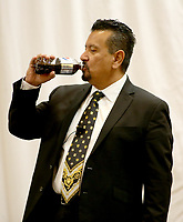 NWA Democrat-Gazette/DAVID GOTTSCHALK Richard Montanez, vice president of Multicultural Marketing at PepsiCo, has a drink of a soda during his opening remarks Thursday, November 8, 2018, at the 2018 Northwest Arkansas Workforce Summit presented by the Springdale Chamber of Commerce at the Holiday Inn Springdale in Springdale. Montanez, the keynote speaker, was working as a janitor when he invented Frito-Lay's best-selling product Flamin' Hot Cheetos.