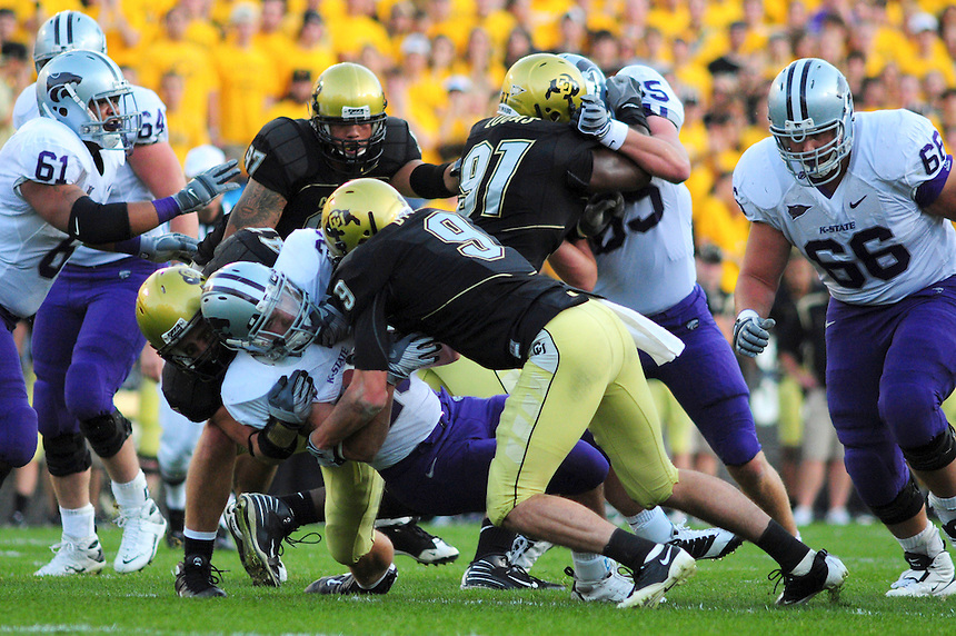 18 October 08: Colorado safety D.J. Dykes (9) tackles Kansas State running back Logan Dold. The Colorado Buffaloes defeated the Kansas State Wildcats 14-13 at Folsom Field in Boulder, Colorado.