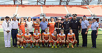 Houston, TX - Sunday Sept. 11, 2016: Houston Dash Starting XI & First Responders prior to a regular season National Women's Soccer League (NWSL) match between the Houston Dash and the Boston Breakers at BBVA Compass Stadium.