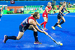 Julia Reinprecht #12 of United States passes the ball during Great Britain vs USA in a women's Pool B game at the Rio 2016 Olympics at the Olympic Hockey Centre in Rio de Janeiro, Brazil.