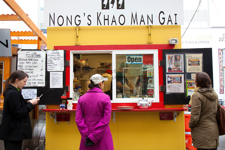 Nong's Khao Man Gai, a Thai food cart featuring the dish, Khao Man Gai, styled authentically after the street vendors of Bangkok.  Chef/Owner Nong Poonsukwattana oversees the one dish food cart in downtown Portland, Oregon
