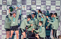 Greater London. United Kingdom, 164th. Men's  University Boat Race Cambridge University celebrate with Champagne on the stage, after winning the 164th. Men's  University Boat Race University Putney to Mortlake,  Championship Course, River Thames, London. <br /> <br /> Saturday  24/03/2018<br /> <br /> [Mandatory Credit:Intersport Images]