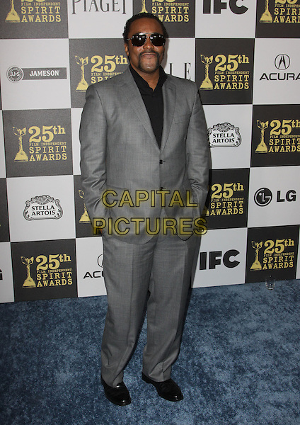 LEE DANIELS.25th Annual Film Independent Spirit Awards held At The Nokia LA Live, Los Angeles, California, USA,.March 5th, 2010 ..arrivals Indie Spirit full length black suit  grey gray sunglasses hands in pockets .CAP/ADM/KB.©Kevan Brooks/Admedia/Capital Pictures