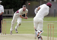 Joel Hughes of North Middx bowls to Michael Philipson during the Middlesex County Cricket League Premier Division game between Hornsey and North Middx at Park Road, Crouch End on Sat June 28, 2014.