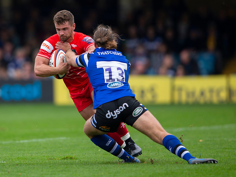 Leicester Tigers' Joe Thomas evades the tackle of Bath Rugby's Max Clark<br /> <br /> Photographer Bob Bradford/CameraSport<br /> <br /> Premiership Rugby Cup Round Three - Bath Rugby v Leicester Tigers - Saturday 5th October 2019 - The Recreation Ground - Bath<br /> <br /> World Copyright © 2018 CameraSport. All rights reserved. 43 Linden Ave. Countesthorpe. Leicester. England. LE8 5PG - Tel: +44 (0) 116 277 4147 - admin@camerasport.com - www.camerasport.com