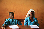 Pupils from the Islamic school in Sunyani, Ghana, listening to the teacher. In Ghana, coranic schools were transformed into islamic schools. Pupils learn the mainstream curriculum and have additional courses in arabic and islam.