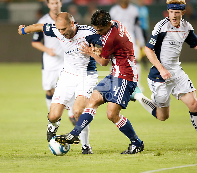 Revolution forward Ilija Stolica (9) and Chivas defender Michael Umana (4) battle for ball during the first half of the game between Chivas USA and the New England Revolution at the Home Depot Center in Carson, CA, on September 10, 2010. Chivas USA 2, New England Revolution 0.