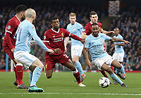 Manchester City's Raheem Sterling drives into the Liverpool box despite the attentions of Liverpool's Georginio Wijnaldum<br /> <br /> Photographer Rich Linley/CameraSport<br /> <br /> UEFA Champions League Quarter-Final Second Leg - Manchester City v Liverpool - Tuesday 10th April 2018 - The Etihad - Manchester<br />  <br /> World Copyright &copy; 2017 CameraSport. All rights reserved. 43 Linden Ave. Countesthorpe. Leicester. England. LE8 5PG - Tel: +44 (0) 116 277 4147 - admin@camerasport.com - www.camerasport.com