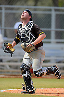 St. Bonaventure Bonnies catcher Nick Lohrer #11 looks for a foul ball pop up during a game against the South Dakota State Jackrabbits at North Charlotte Regional Park on February 23, 2013 in Port Charlotte, Florida.  South Dakota State defeated St. Bonaventure 10-5.  (Mike Janes/Four Seam Images)