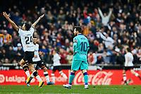 25th January 2020; Mestalla, Valencia, Spain; La Liga Football,Valencia versus Barcelona; Lionel Messi of FCB, and Ezequiel Garay of Valencia CF react after the goal scored by Maxi Gomez of Valencia CF in minute 77' for 2-0