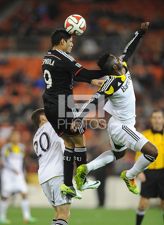 Washington D.C. - March 8, 2014: Fabian Espindola (9) of D.C. United heads the ball against Waylon Francis (14) of the Columbus Crew.   The Columbus Crew defeated D.C. United 3-0 during the opening game of the 2014 season at RFK Stadium.
