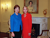 Washington, DC - October 2, 2001 -- First Lady Laura Bush meets with Miss America 2001 Katie Harman at the White House, Tuesday, October 2, 2001.  They are posed in front of a portrait of former first lady Lady Bird Johnson, wife of former United States President Lyndon Baines Johnson.<br /> Credit: Moreen Ishakawa - White House via CNP