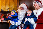 BETHLEHEM, CT. 07 December 2018-120718 - Noah Jedd, 2 1/2, left, wants to get off Santa's lap as his brother Benjamin, 8 months old, looks on with Mrs Claus during the annual Christmastown Festival on the Town Green in Bethlehem on Friday. Bill Shettle Republican-American