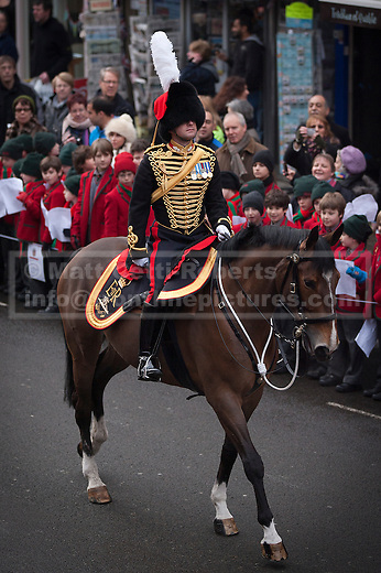 06/02/2012. LONDON, UK. A officer of the Kings Troop Royal Horse Artillery rides past school children and members of the public as his unit parades on St John's Wood High Street during a farewell ceremony there. Gunners of the Kings Troop, based at St John's Wood since 1947, today (06/02/12) left their barracks for the last time to fire their guns in Hyde Park, the soldiers will move tomorrow to their new home in Woolwich. Photo credit: Matt Cetti-Roberts