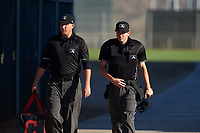 Umpires Larry Dillman Jr. and Tyler Wall walk toward the field before an Arizona League game between the AZL Padres 1 and AZL Indians Red on June 23, 2019 at the Cleveland Indians Training Complex in Goodyear, Arizona. AZL Indians Red defeated the AZL Padres 1 3-2. (Zachary Lucy/Four Seam Images)