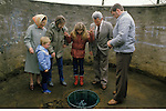 St Marys Well Clootie Well Culloden Moor Smithton Invernesshire  Scotland Reen girls drops a penny in well and makes a wish.