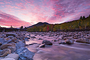 Black Mountain from along the East Branch of the Pemigewasset River, near the Loon Mtn. bridge, in Lincoln, New Hampshire at sunrise on an autumn day.