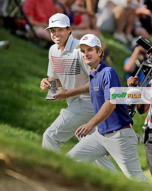 22 June14 Nick Watney and a beaming Kevin Streelman walk off the 18th at the conclusion of Sunday's Final Round of The Travelers Championship at The TPC River Highlands in Cromwell, Connecticut. (photo credit : kenneth e. dennis/kendennisphoto.com)