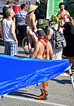 People check out vendor booths at the 11th Annual World Naked Bike Ride which was held Saturday in The Grove. Hundreds of participants wore nothing or next to nothing before, during and after the bicycle ride. There was also a costume contest, a drag show, music, food, vendor booths, and dancing.   Photo by Tim Vizer