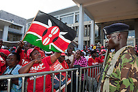 Independent Electoral and Boundaries Commission (IEBC) declared Uhuru Kenyatta as the winner of the presidential contest on 9 March 3013, after the failure of the electronic results transmission system delayed the process. Crowds of Jubilee supporters await an address by Uhuru Kenyatta and William Ruto at Catholic University, the Jubilee campaign headquarters, amid heavy security in Nairobi on 9 March 2013.