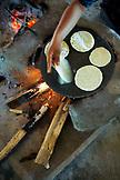 BELIZE, Punta Gorda, Toledo District, Cheratina Mes makes tortillas for lunch, San Jose Maya Village