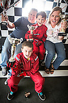 © Joel Goodman - 07973 332324 . 4 August 2013 . Daytona Manchester, Unit 4 Circle South, Wharfside Way, Trafford Park, Manchester M17 1NF , UK . L-R son Gabe Burrows (front) (12) , dad Joe Burrows (42) , son Michael Burrows (nine) and mum Sally Burrows (42) from Stretford (correct - NB Gabe just recently turned nine - it says eight on the brief) . Gabe and Michael have won numerous go-karting trophies . Photo credit : Joel Goodman