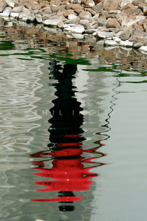 Tiger Woods (USA) reflection in the water on the 4th hole during the final round of the Dubai Desert Classic at Emirates Golf Club in Dubai, UAE. Picture Credit / Phil Inglis