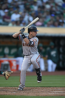 OAKLAND, CA - JULY 20:  Buster Posey #28 of the San Francisco Giants bats against the Oakland Athletics during the game at the Oakland Coliseum on Friday, July 20, 2018 in Oakland, California. (Photo by Brad Mangin)