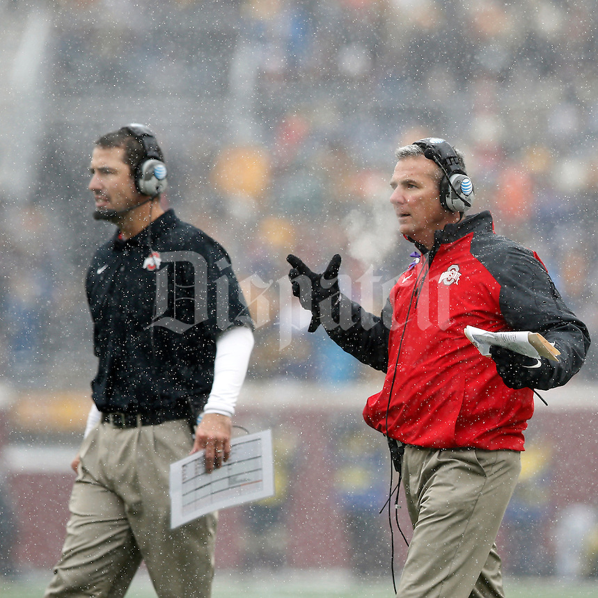 Ohio State Buckeyes head coach Urban Meyer looks at his defense after they gave up a touchdown on a 3rd down and long against Minnesota Golden Gophers during the 2nd quarter at TCF Bank Stadium in Minneapolis, Minn. on November 15, 2014.  (Dispatch photo by Kyle Robertson)