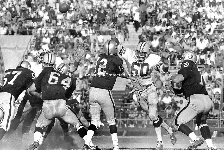 Raiders vs. Packers: .Ken Stabler rushed by Green Bay lineman          Oakland blockers George Buehler and Harry Schuh. (1970 photo/Ron Riesterer)