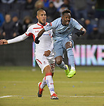Gerso Fernandes of Sporting KC (right) watches as his shot goes in the goal against Toluca during their CONCACAF Champions League game on February 21, 2019 at Children's Mercy Park in Kansas City, KS. At left is Jonatan Maidanal of Toluca. <br /> Tim VIZER/Agence France-Presse