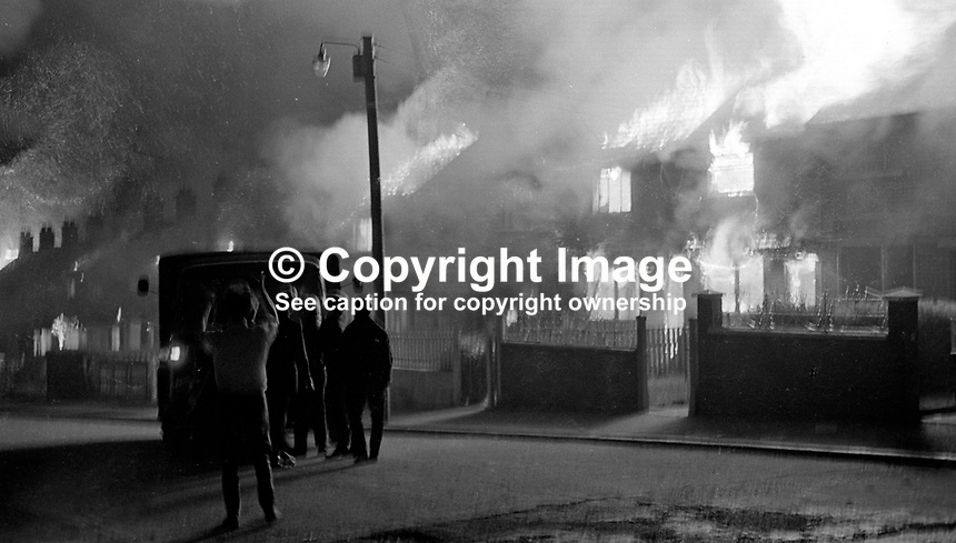 Protestant families who felt it necessary to abandon their homes in Farringdon Gardens, Ardoyne, Belfast, N Ireland, as a result of post-internment rioting, set fire to them to prevent them being taken over by Roman Catholics from adjoining areas. 197108090389n..Copyright Image from Victor Patterson, 54 Dorchester Park, Belfast, UK, BT9 6RJ..Tel: +44 28 9066 1296.Mob: +44 7802 353836.Voicemail +44 20 8816 7153.Skype: victorpattersonbelfast.Email: victorpatterson@me.com.Email: victorpatterson@ireland.com (back-up)..IMPORTANT: If you wish to use this image or any other of my images please go to www.victorpatterson.com and click on the Terms & Conditions. Then contact me by email or phone with the reference number(s) of the image(s) concerned.