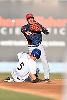Rome Braves second baseman Derian Cruz (7) attempts to turn a double play over a hard sliding Matt McLaughlin (5) during a game against the Asheville Tourists at McCormick Field on June 5, 2018 in Asheville, North Carolina. The Tourists defeated the Braves 11-6. (Tony Farlow/Four Seam Images)