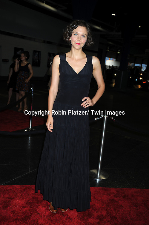 Maggie Gyllenhaal in Balenciaga black dress posing for photographers at The Fresh Air Fund's Salute to American Heroes Gala on June 3, 2010 at Pier Sixty at Chelsea Piers in New YOrk City.