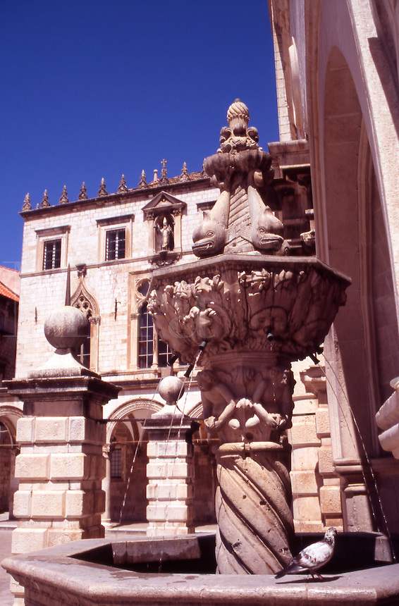 Croatia. Dubrovnik Old City. Small Onofrio's Fountain and Sponza Palace, Luzia (Loggia Square) Stradun