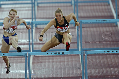 9 August 2005: German hurdler Kirsten Bolm (GER) competes in the Women's 100m Hurdles at the IAAF World Athletics Championships, held in the Olympic Stadium, Helsinki, Finland Photo: Glyn Kirk/actionplus...050809  woman women female athlete hurdling