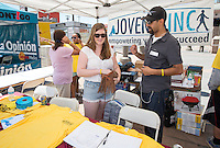 Abbey Hastings '16 interns for Jovenes Inc. at their booth in Boyle Heights, Aug. 17, 2013 as part of the CDC's InternLA program.<br />