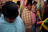Aymara women during the parade to celebrate the day of El Alto.	Just 25 years ago it was a small group of houses around La Paz  airport, at an altitude of 12,000 feet. Now El Alto city  has  nearly one million people, surpassing even the capital of Bolivia, and it is the city of Latin America that grew faster .<br /> 	It is also a paradigmatic city of the tubles and traumas of the country. There got refugee thousands of miners that lost  their jobs in 90 &acute;s after the privatization and closure of many mines. The peasants expelled by the lack of land or low prices for their production. Also many who did not want to live in regions where coca  growers and the Army  faced with violence.<br /> 	In short, anyone who did not have anything at all and was looking for a place to survive ended up in El Alto.<br /> 	Today is an amazing city. Not only for its size. Also by showing how its inhabitants,the poorest of the poor in one of the poorest countries in Latin America, managed to get into society, to get some economic development, to replace their firs  cardboard houses with  new ones made with bricks ,  to trace its streets,  to raise their clubs, churches and schools for their children.