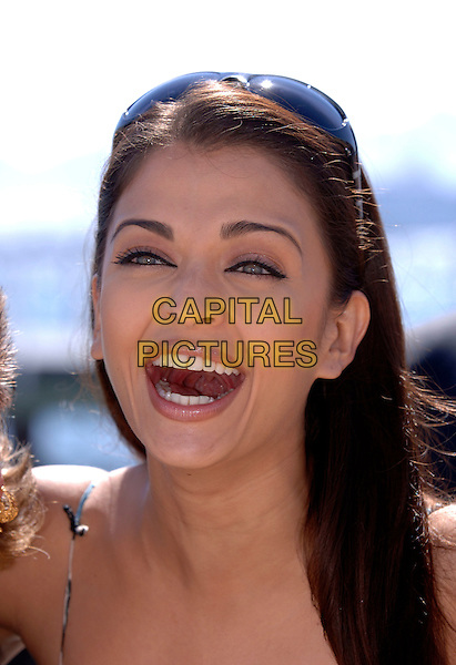 AISHWARYA RAI.In Cannes during the 59th International Cannes Film Festival, Cannes, France..May 19th, 2006.Ref: FIN.headshot portrait sunglasses shades  mouth open laughing.www.capitalpictures.com.sales@capitalpictures.com.© Capital Pictures.