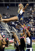Florida International University cheerleaders perform during the game against Troy University on October 26, 2011 at Miami, Florida. FIU won the game 23-20 in overtime. .